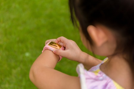 Foto per Kid Using Smartwatch or Smart Watch. Kid with Smartwatch or Smart Watch - Immagine Royalty Free