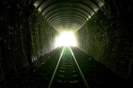 Light at the entrance of train tunnel.
