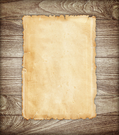 Photo pour Old paper on wood background. - image libre de droit