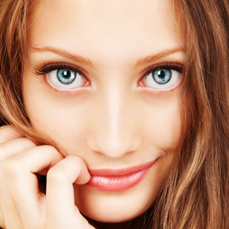 Photo for Portrait of a young woman with beautiful hair and blue eyes - Royalty Free Image