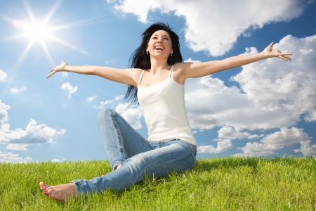 Foto de happy young woman dreams to fly on winds - Imagen libre de derechos