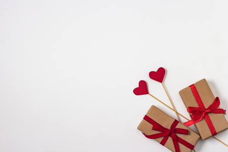 Photo pour Hearts on Sticks, Two Gifts on the White Background. top view. - image libre de droit