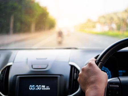 Photo pour Man's hands holding steering wheel and blur road background. Driving concept - image libre de droit