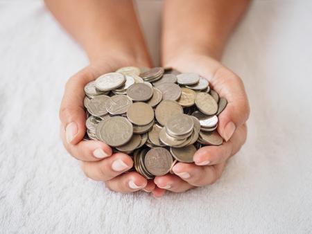 Photo pour Woman hands holding coins on white background. saving money, finacial concept. - image libre de droit