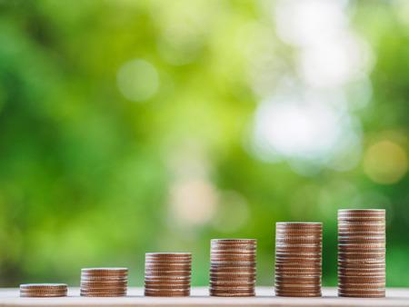 Foto de Saving money concept.  growing business concept. money coin stack on the table on bokeh background. - Imagen libre de derechos