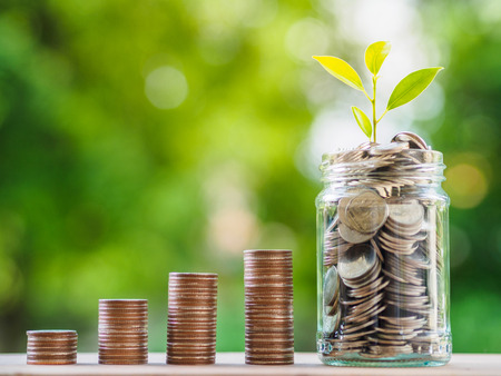 Foto de Saving money concept.  growing business concept. money coin stack on the table on bokeh background. - Imagen libre de derechos