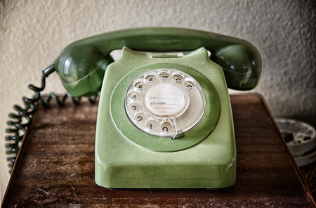 Photo pour Close up of an old telephone on the table. Vintage telephone with rotary dial. Communication concept. - image libre de droit