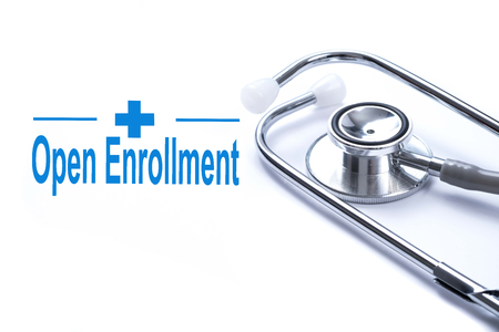 Foto de Page with Open Enrollment on the table with stethoscope, medical concept. - Imagen libre de derechos