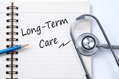 Photo pour Stethoscope on notebook and pencil with Long Term Care words as medical concept - image libre de droit