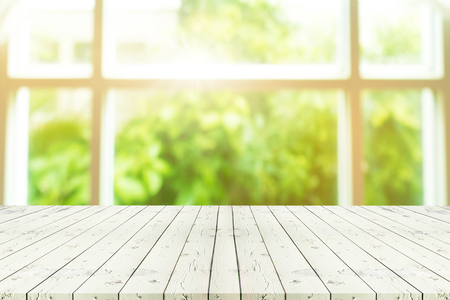 Foto de Perspective wooden table on top over blur background view from the coffee shop window, can be used mock up for montage products display or design layout. - Imagen libre de derechos