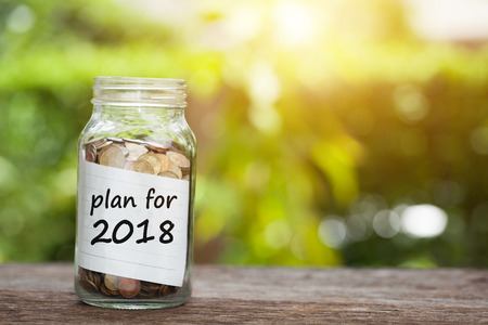 Photo pour Plan For 2018 Word With Coin In Glass Jar. - image libre de droit