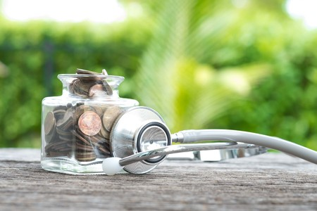 Photo pour Coin bottle ,stethoscope on wooden. concept of financial planning for health care. - image libre de droit