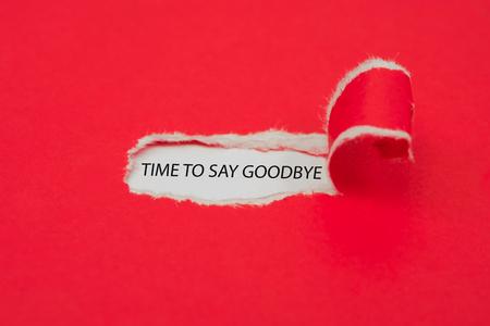 Foto de Torn red paper revealing the word Time to say goodbye. Business concept. - Imagen libre de derechos