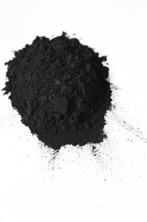 Photo for Activated charcoal powder shot with a macro lens - Royalty Free Image