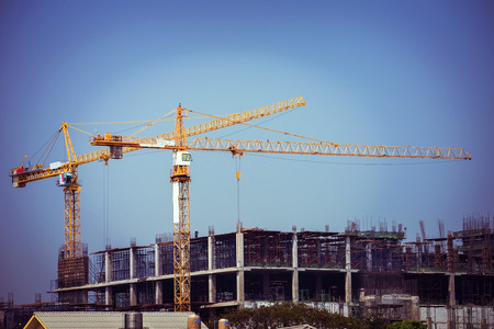 Photo pour crane construction industry background, retro tone image - image libre de droit