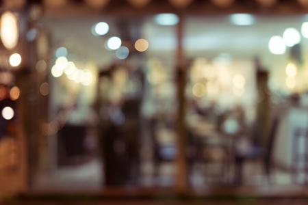 Foto de abstract blur image decoration interior restaurant with light glittering in the night - Imagen libre de derechos