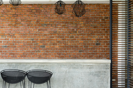 Foto per cement counter nightclub with seat bar stool and brick wall background - Immagine Royalty Free