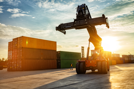 Photo for Thailand Laem Chabang Chonburi Industrial logistic forklift truck containers shipping cargo in port at sunset time. - Royalty Free Image