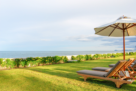 Photo for chairs and umbrella on the beach - Royalty Free Image
