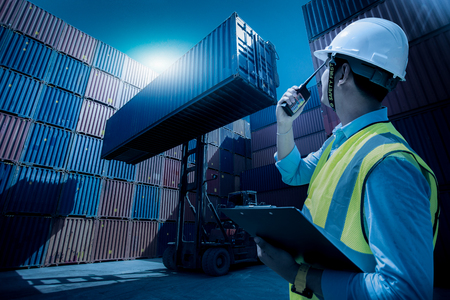 Photo for Foreman control loading containers box from cargo freight ship for import export, Foreman control industrial container cargo freight ship, Business logistic concept, Import and export concept - Royalty Free Image