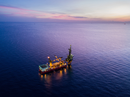 Photo for Aerial View of Tender Drilling Oil Rig (Barge Oil Rig) in The Middle of The Ocean at Surise Time - Royalty Free Image