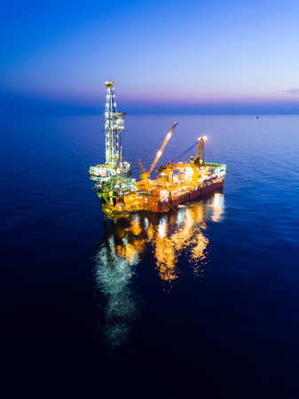 Photo for Aerial View of Tender Drilling Oil Rig (Barge Oil Rig) in The Middle of The Ocean at Sunrise Time - Royalty Free Image