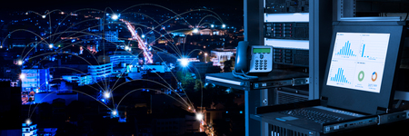 Foto de Management and monitoring monitor in data center and connectivity lines over night city background, smart city concept - Imagen libre de derechos