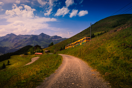 Foto de Colorful landscape in the Jungfrau region with the mountain train from Lauterbrunnen to Kleine Scheidegg. Wengen, Bernese Alps, Switzerland - Imagen libre de derechos