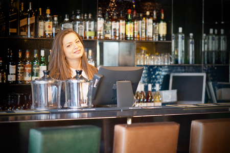 Photo for A restaurant worker registrating new order by cash-register - Royalty Free Image