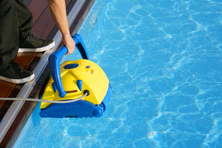 Photo pour Pool cleaner during his work. Cleaning robot for cleaning the botton of swimming pools. - image libre de droit