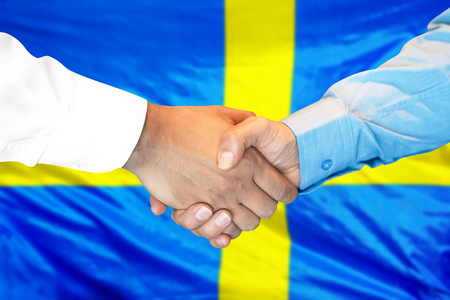 Photo for Business handshake on Swedish flag background. Men shaking hands and Swedish flag on background. Support concept - Royalty Free Image