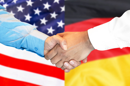 Photo for Business handshake on the background of two flags. Men handshake on the background of the Germany and United States of America flag. Support concept - Royalty Free Image