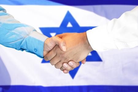 Photo for Business handshake on Israel flag background. Men shaking hands and Israeli flag on background. Support concept - Royalty Free Image