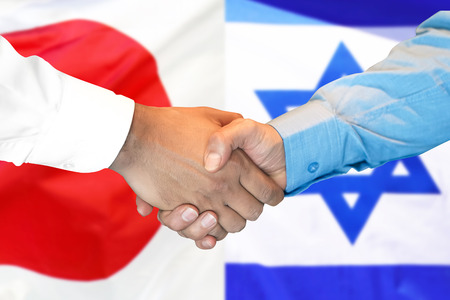 Photo for Business handshake on the background of two flags. Men handshake on the background of the Japan and Israel flag. Support concept - Royalty Free Image