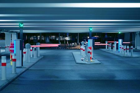 Foto de Barrier at Entrance and exit of a car Parking garage. barrier in a car park. Exit from underground parking. Underground parking/garage. Interior of parking. Toning - Imagen libre de derechos