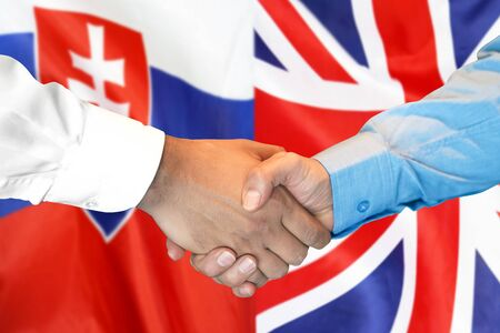 Photo for Business handshake on the background of two flags. Men handshake on the background of the Slovakia and United Kingdom flag. Support concept - Royalty Free Image