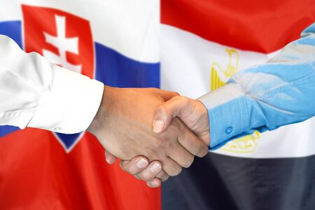 Photo for Business handshake on the background of two flags. Men handshake on the background of the Slovakia and Egypt flag. Support concept - Royalty Free Image