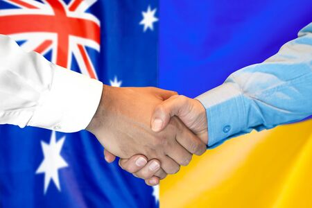 Photo for Business handshake on the background of two flags. Men handshake on the background of the Australia and Ukraine flag. Support concept - Royalty Free Image