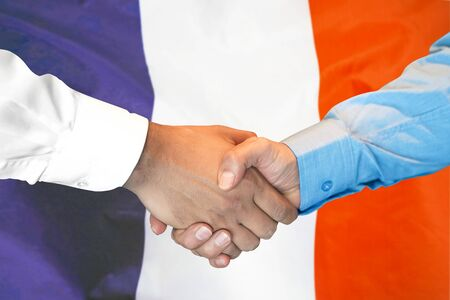 Photo for Business handshake on France flag background. Men shaking hands and French flag on background. Support concept - Royalty Free Image