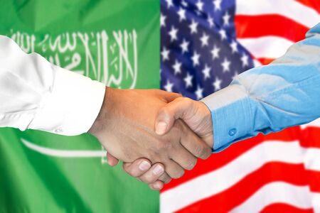 Photo for Business handshake on the background of two flags. Men handshake on the background of the Saudi Arabia and United States of America flag. Support concept - Royalty Free Image