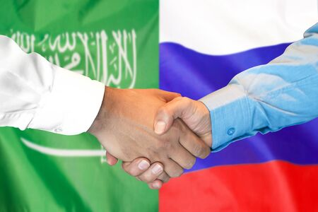 Photo for Business handshake on the background of two flags. Men handshake on the background of the Saudi Arabia and Russia flag. Support concept - Royalty Free Image