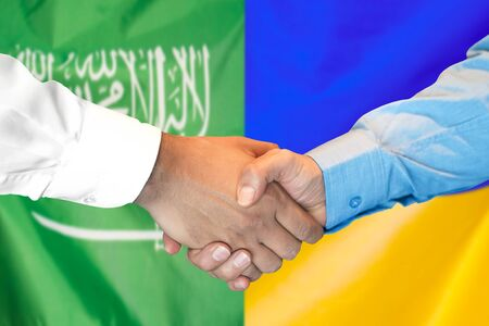 Photo for Business handshake on the background of two flags. Men handshake on the background of the Saudi Arabia and Ukraine flag. Support concept - Royalty Free Image