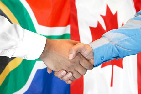 Photo for Business handshake on the background of two flags. Men handshake on the background of the South Africa and Canada flag. Support concept - Royalty Free Image