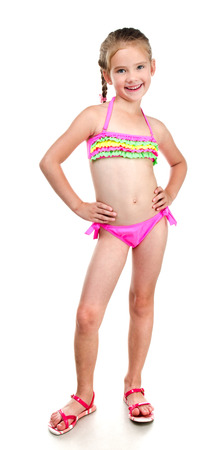 Photo for Cute smiling little girl in swimsuit isolated on a white - Royalty Free Image
