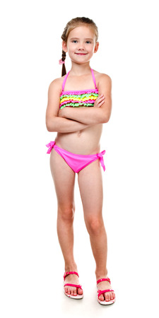 Foto de Cute smiling little girl in swimsuit isolated on a white - Imagen libre de derechos