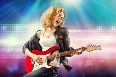 Photo for Portrait of young beautiful woman playing the guitar  Happiness concept  - Royalty Free Image