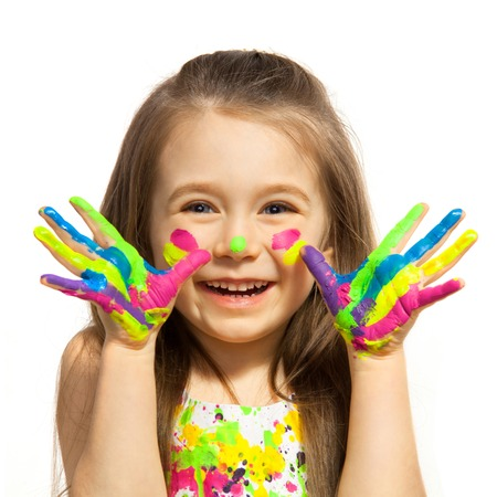 Foto de Funny little girl with hands painted in colorful paint  Isolated on white background  - Imagen libre de derechos