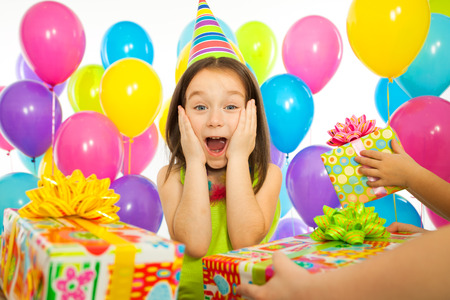 Photo for Joyful little kid girl receiving gifts at birthday party. Holidays, birthday concept. - Royalty Free Image