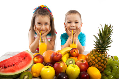 Foto per Happy children with fruits, healthy eating kids concept.  Isolated on white background. - Immagine Royalty Free