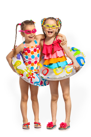Photo for Happy kids in swimsuit and inflatable rings. Isolated on white background. Summer, fashionable, friendship concept. - Royalty Free Image